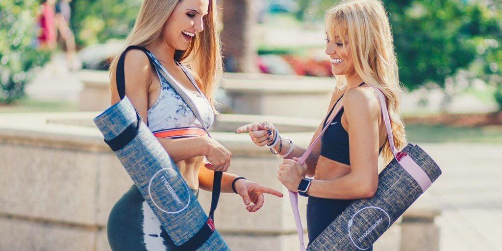 women-carrying-fabric-yoga-mats