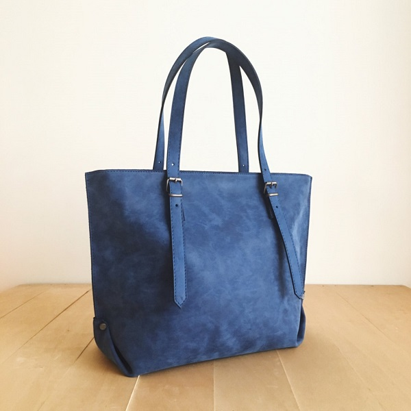 blue canvas bag with leather straps