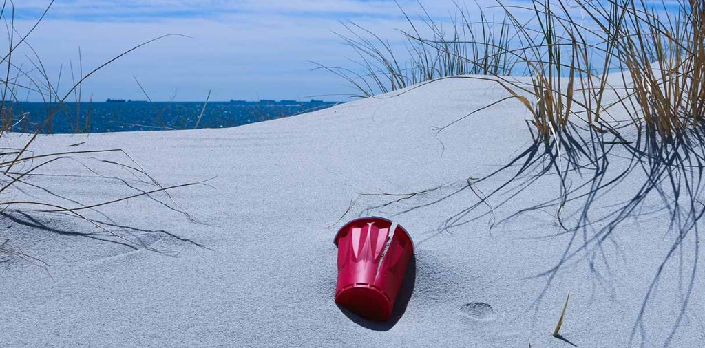 plastic cup on the beach